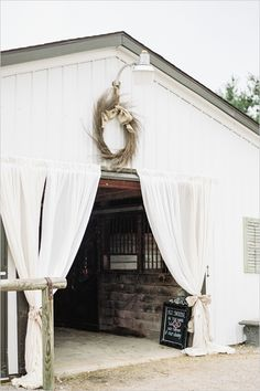 barn wedding reception - love the drapes. Would love something similar at the entrance of the marquee