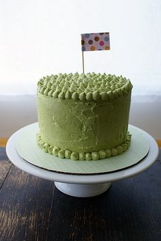 matcha green tea buttercream frosted vanilla cake with party flag - by Coco Cake.