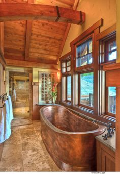 Log cabin bathroom...gorgeous copper tub