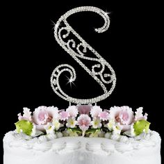 """Add style to any special event or wedding cake with these intricately styled Swarovski Romanesque cake letters. With dozens of sparkling Swarovski Crystals, woven into a silver plated frame to make this block style letter, your guests are sure to be wowed.Small (Height) 3"""" to 3 1/4"""" Large (Height) 4 1/4"""" to 4 1/2""""If you would like to see a photo of a particular letter before purchase, please email us."""