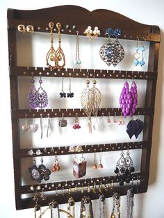 Upcycle a spice rack. Can't wait for a more stylish, better way to organize my jewelry.