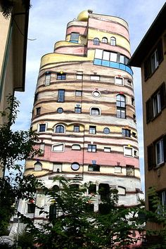 """Waldspirale"" (""forest spiral""), Darmstadt, Germany. Designed by Friedensreich Hundertwasser (and so like other of his buildings often referred to as Hundertwasserhaus). Opened 2000."
