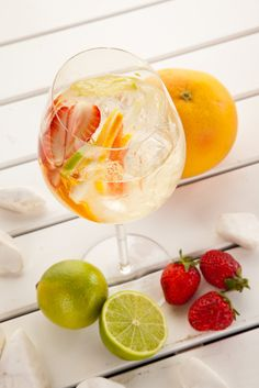 Sunset Sangria - White Wine Sangria made with Champagne, Chardonnay and Sauvignon Blanc infused with Fresh Peaches