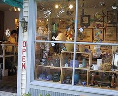 The Secret Garden  Gallery with whimsical, contemporary, affordable art. More than 200 artists from North America, and many artists from Michigan. Paintings, woods, glass, mobiles, pottery, jewelry, wearables, photography and more.    Open daily May through January 1st and weekends in January.  10206 Front Street, downtown Empire  231.326.5428