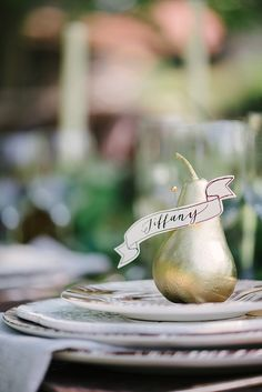 spray painted gold pear place card holders
