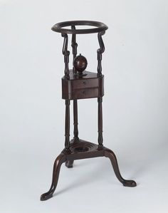 Washstand, made 1740-1770, Carved and turned mahogany.