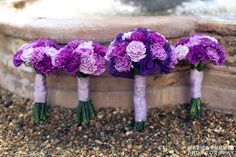 Bridal Party Bouquets in shades of purple - photo by Mariea Rummel Photograpy