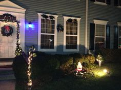 Another picture of the outside during Christmas 2012. The swags above the windows were also created from discarded artificial tree branches.