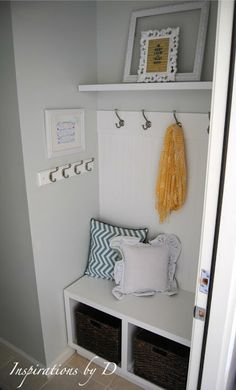 Remove the door & frame to your foyer closet and create this mini mudroom w/bench & hooks!!! Great idea, since that closet always ends up being a collecting place for unused junk anyway!