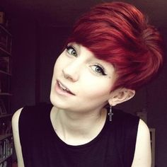 Love that shade of red. Don't think I could ever cut my hair that short but it looks great on her.