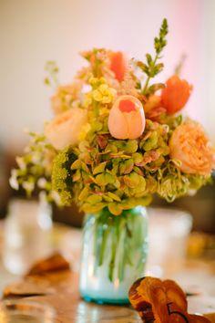 hydrangea and tulip centerpiece, photo by Al Gawlik Photography http://ruffledblog.com/pecan-springs-ranch-wedding #weddingideas #flowers #weddingcenterpieces