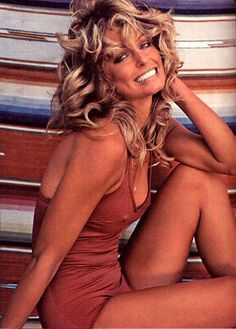 "Farrah Fawcett  Farrah Fawcett became famous through a combination of the hit 70′s series ""Charlie's Angels"" and this photograph which was popularized as a poster. Date: 1976. Photographer: Bruce McBroom."