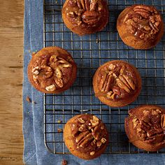 Sticky-Bun Pumpkin Muffins | Sticky buns and pumpkin bread combine in this amazing muffin recipe. A mixture of toasted pecans, butter, and brown sugar creates the sweet topping.