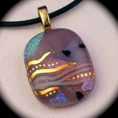 Fused glass jewelry. I did not make this piece, but my daughter and I make and sell fused glass