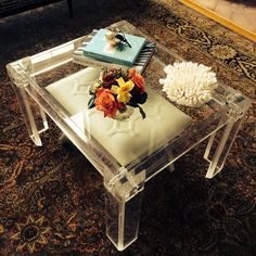 This HomeGoods stool adds depth to this lucite vintage table and adds additional seating that is tucked away. #sponsored