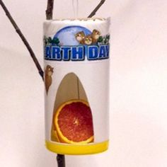 Recycled Bird Feeder to provide our feathered friends with special treats. More Earth Day crafts on freekidscrafts.com