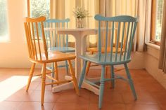 Love the painted vintage chairs.