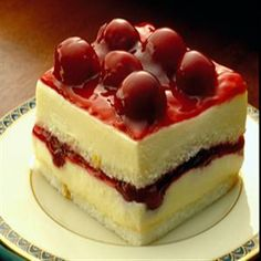 Cherry Angel Cream Cake.   :-)  An easy recipe that looks like you spent a lot of time. :-)  A fun cake for a Christmas gathering!