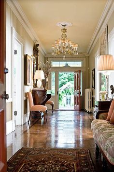 This entry hall has doors on both sides, perfect for embracing those hot summer days! - Traditional Home® the doors, blue room, decorating ideas, front doors, foyer, hous, hallway, entry hall, traditional homes