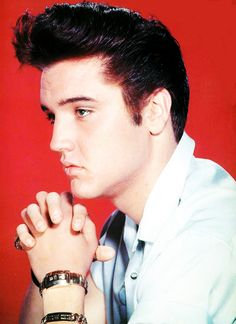 Elvis Presley in a publicity photo for Jailhouse Rock (1957).  Elvis was hot before he started wearing the Karate-looking clothes.