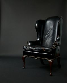 love a good black leather wingback