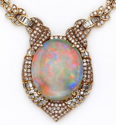 An opal, diamond, and 18k gold pendant necklace with an 65 carat oval-shaped opal within a horseshoe-shaped surround of round brilliant, baguette, and pavé-set diamonds . . . completed by a necklace of foliate motif set with round brilliant and baguette-cuts and plain backchain; estimated 5.5 carat total diamond weight. gold pendant, pendants, jewel, weights, diamonds, opal diamond, necklaces, opals