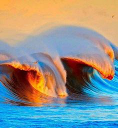 Breaking waves at sunset