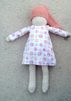hand knit dolly with nightcap and sleeping gown