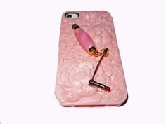 Mini Stylus in pink.  Use on Iphone, Ipad, Blackberrys, Smartphones, Ipod .........