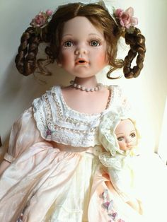 Victorian porcelain doll with baby doll
