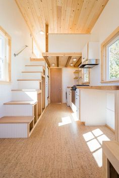 Inside the custom tiny home are white beadboard walls, cork flooring, and natural wood finishes.