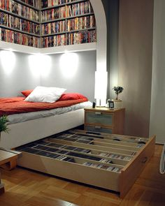 the bookshelf above the bed is a great idea, i would probably use the under bed drawer for other things though