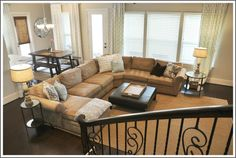 Favorite family room color combo. Beige, gray, smoky blue with dark wood floors