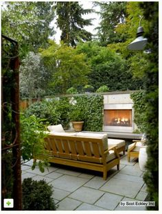Great outdoor sitting area, perfect for relaxing on a chilly spring night by the outdoor fireplace! Climbing Plants Suit Small Gardens