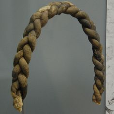 a false braid made from padded cloth-tubes, 15th/16th century, Kempten, Germany (Allgäuer Landesmuseum, Kempten)
