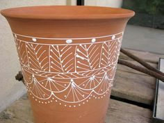 Paint your terracotta pot with puffy paint - great idea from anthropologie.  Bird designs would look great too.