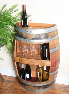 Wine Gift - This Wine Barrel Cabinet takes up very little room but allows a great area for storing your glasses and bottles or knicknacks.