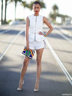 White outfit n colorful clutch
