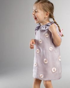 this is neiman marcus' actual photo from their actual website to sell this $350 toddler dress.  it makes me laugh.