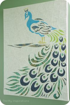 PeacockPaperCraftCanvasFull  neutral paper torn and mod poged onto a canvas,  scrapbook paper cut in shapes for each piece of peacock
