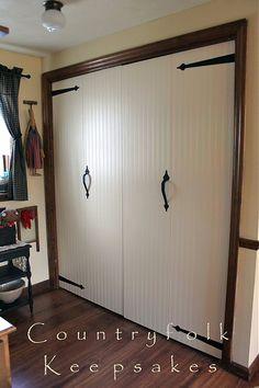 after adding beadboard wallpaper and hardware to bi-fold doors