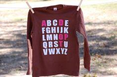 ADOPT shirt.
