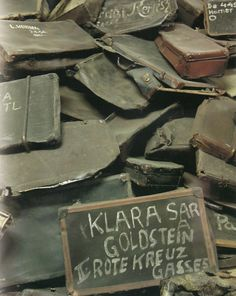This is a photograph of the discarded suitcases of the victims of Auschwitz.