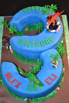 """It was a Twin affair!  Two customized 10-inch round cakes, one in """"Butta-licious"""" and the other is """"just Chocolate"""" that were cut to form the number """"3""""!  The cake was iced in fondant.  The base of the non-edible trees were chocolate rocks!  Fondant accents were also used.  www.pinkpiggysweets.com"""