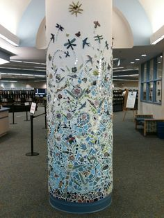 Mosaic at the Deltona, FL Public Library: Community members of all ages were invited to make the  ceramic pieces.