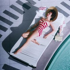 Austrian actress Mara Lane lounging by the pool in a red and white striped bathing costume at the Sands Hotel, Las Vegas, 1954. Photo by Slim Aarons/Hulton Archive/Getty Images.