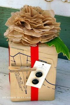 Love this gift wrapped in an old sewing materials!