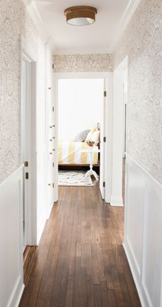 LOVE this hallway and the Oh Joy! Wallpaper... gorgeous hardwood floors, bright and airy...