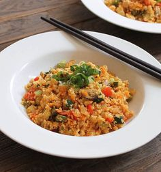 """Cauliflower """"Fried Rice."""" Riced cauliflower packed with veggies and stir-fried in spicy ginger-Sriracha. Vegetarian, Paleo, and straight up healthy awesomeness!"""