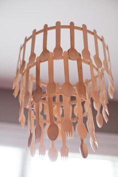 Wooden Utensil Chandelier-hot glue wooden utensils to wooden embroidery rings. Then use fishing line to tie them together in tiers.